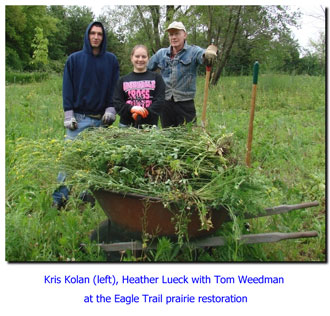 Kris Kolan Heather Lueck with Tom Weedman at the Eagle Trail prairie restoration