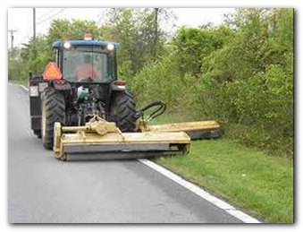 tracktor mowing side of highway