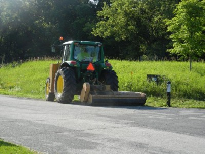 tractor mowing side of road