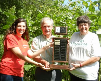 SEWISC Presents the Pull A Thon Trophy to the Caledonia Conservancy Staff and Volunteers